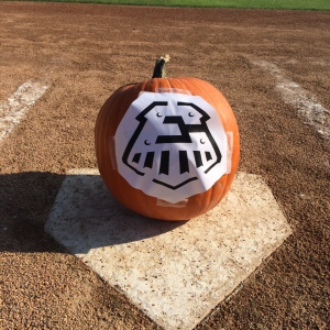 Here's our stencil taped to the center of the pumpkin.